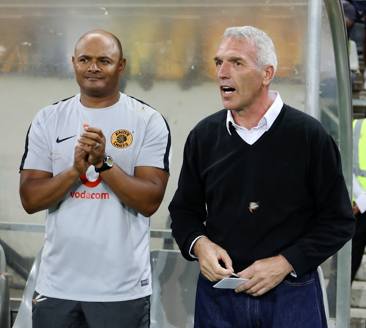 Kaizer Chiefs coach Ernst Middendorp (R) and his assistant Shaun Bartlett (L) look on during an Absa Premiership match against SuperSport United at Mbombela Stadium in Nelspruit, Mpumalanga, on December 12 2018.