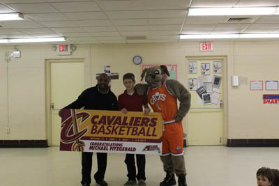 Photo: Ahmaad Crump and Moondog surprised FitzGerald at his school on March 5th to announce the honor!