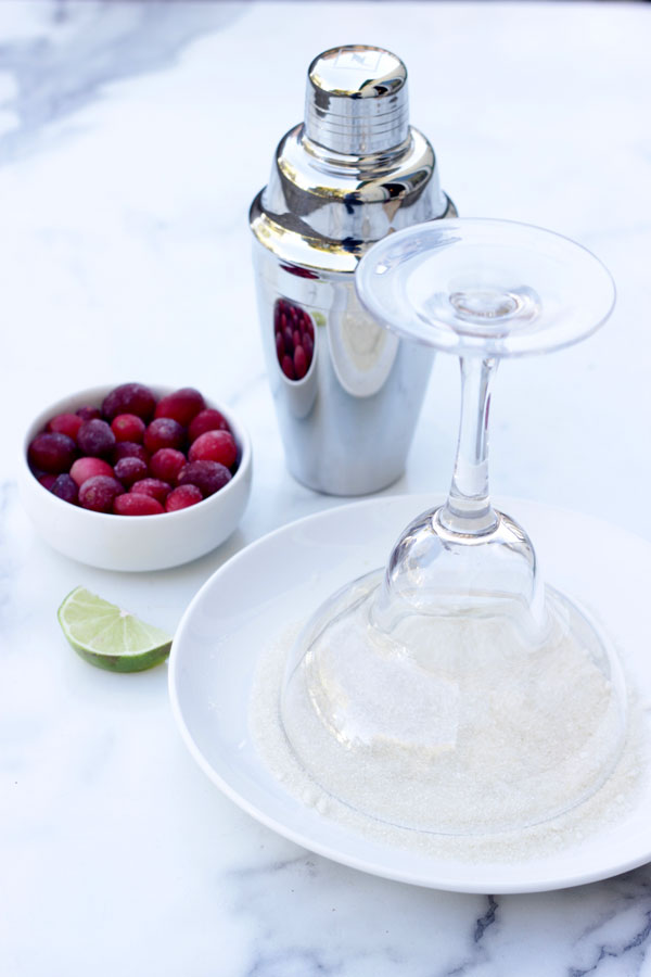 rimming a margarita glass with sugar