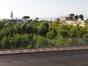 Photo: View from our apartment in Sorrento. The hotel where we had pool/ocean passes is the white building to the far right