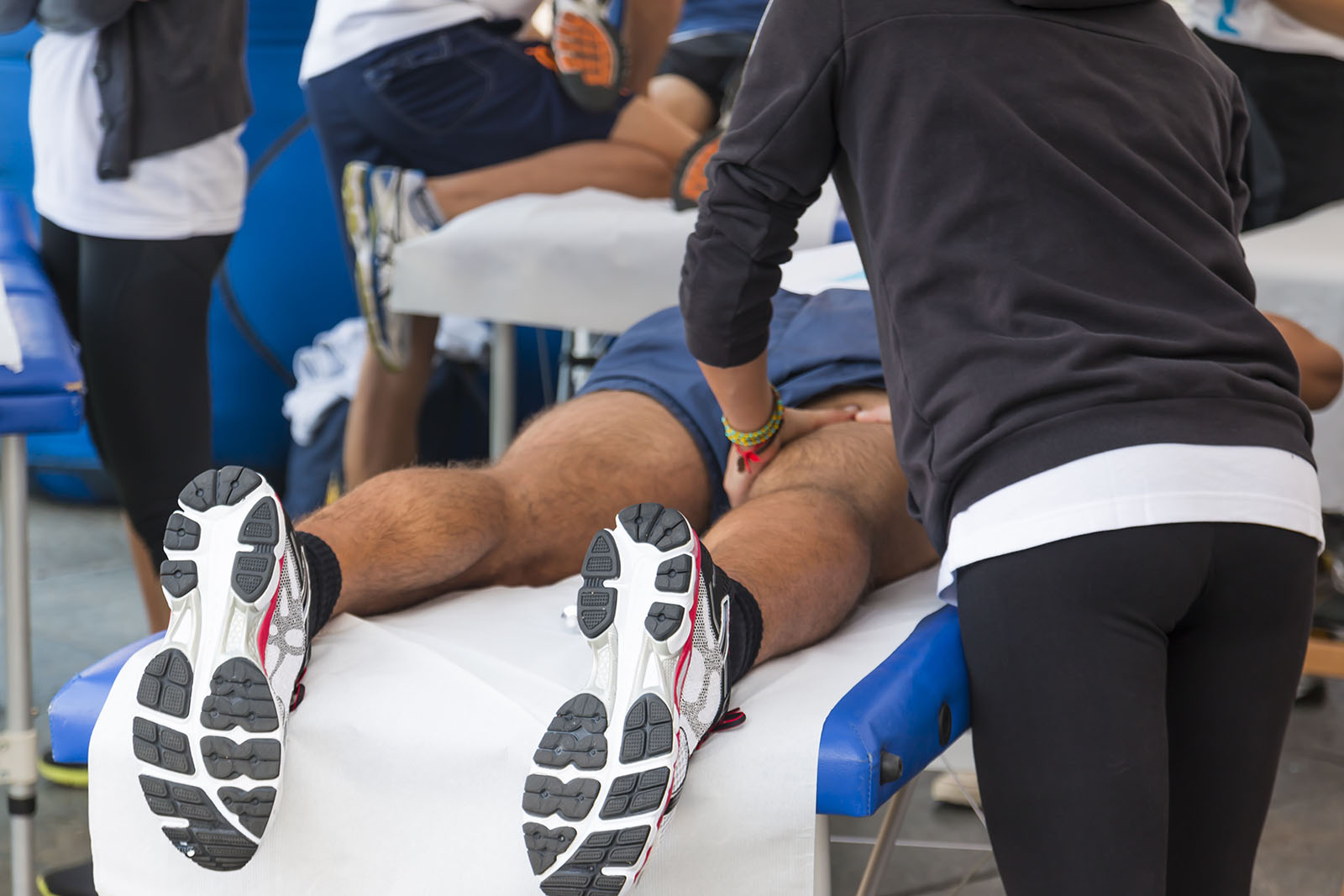 Athletic trainer working with an athlete in the training room