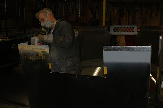 Photo: Charls busy working on the right-rear bottom edge of CBL's body.  Here you can see the original Woodings factory body paint (CPR Yellow) under the OCR black.  Photo by J. Loucks