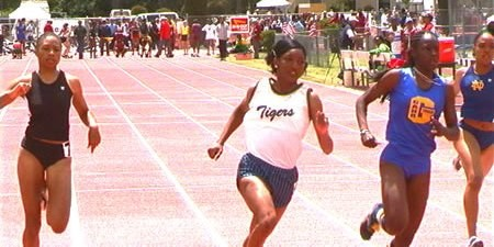 Monique winning the Mt. SAC 100 over Angel Perkins (right) and Allyson Felix.  Photo by John Dye.