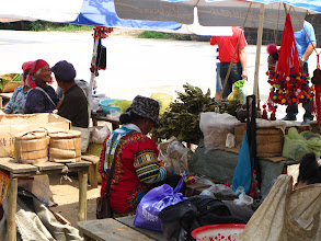 Photo: The local Nan Nuo Mountain Farmer's Market. The native farmers sell their extra produce, including puer tea.