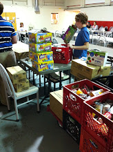 Photo: The items are sorted and then assembled. They put together at least 70 bags of food each week.