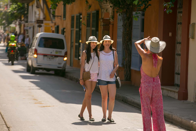 Visitors pose in a tourism area of Old Cartagena, Colombia.