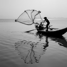 Fisherman's net by ANANT KUMAR - Black & White Portraits & People ( fishing, silhouette, people, fisherman )