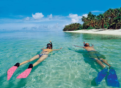 Tonga-snorkel-pair.jpg - Enjoy a leisurely snorkel in the crystal clear waters of Tonga.