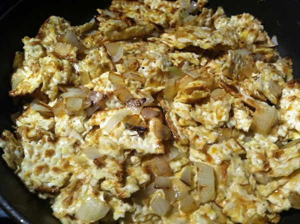 Add eggs to matzo along with salt and pepper. Put in pan and flatten...