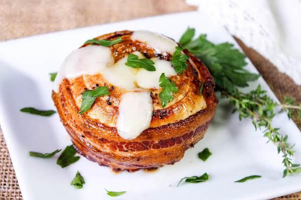 Smoked Bacon Wrapped French Vidalia Onion On A Plate.