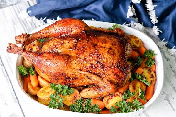 Roast Sticky Chicken Rotisserie In A Roasting Pan With Vegetables.