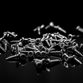 screws on black background by Roberto Sorin - Artistic Objects Technology Objects ( repair, steel, spanner, isolated, mechanic, industry, instrument, tools, fix, design, screw, construction, nobody, hand, hardware, macro, set, chrome, old, texture, work, workshop, carpentry, black, metal, equipment, screwdriver, handle, technology, improvement, metallic, stainless, tool, home, wrench, single, industrial, plastic, build, closeup, background, iron, shiny, silver, bolt, detail, object )