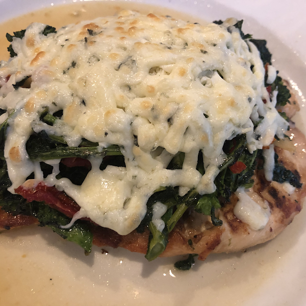 Grilled Chicken with broccoli rabe, sun-dried tomatoes, gorgonzola cheese