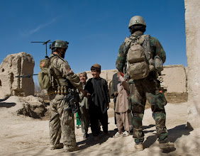 Photo: A U.S. Special Forces Soldier assigned to Special Operations Task Force – South greet Afghan children during a security patrol Feb. 20, 2011 in Panjwai District, Kandahar Province, Afghanistan. The SOTF-South Special Forces team in the area conducts regular patrols in order to bolster security as well as to meet with area villagers to assess development projects.    (U.S. Army photo by Spc. Kelly Fox)(Released).