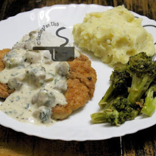 Chicken Steak With Cheesy Mushroom Sauce, Mashed Potato And Stir Fry Garlic Broccoli.