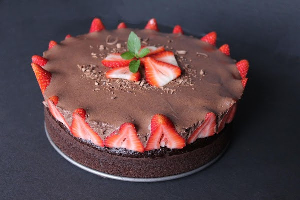 Carefully remove the springform pan and top the cake with the remaining strawberries. ...