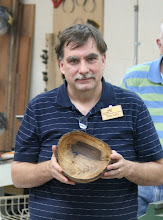 Photo: Tim Aley presents his natural edged bowl that was the latest item that came off the lathe.