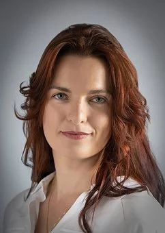 headshot of woman with red hair