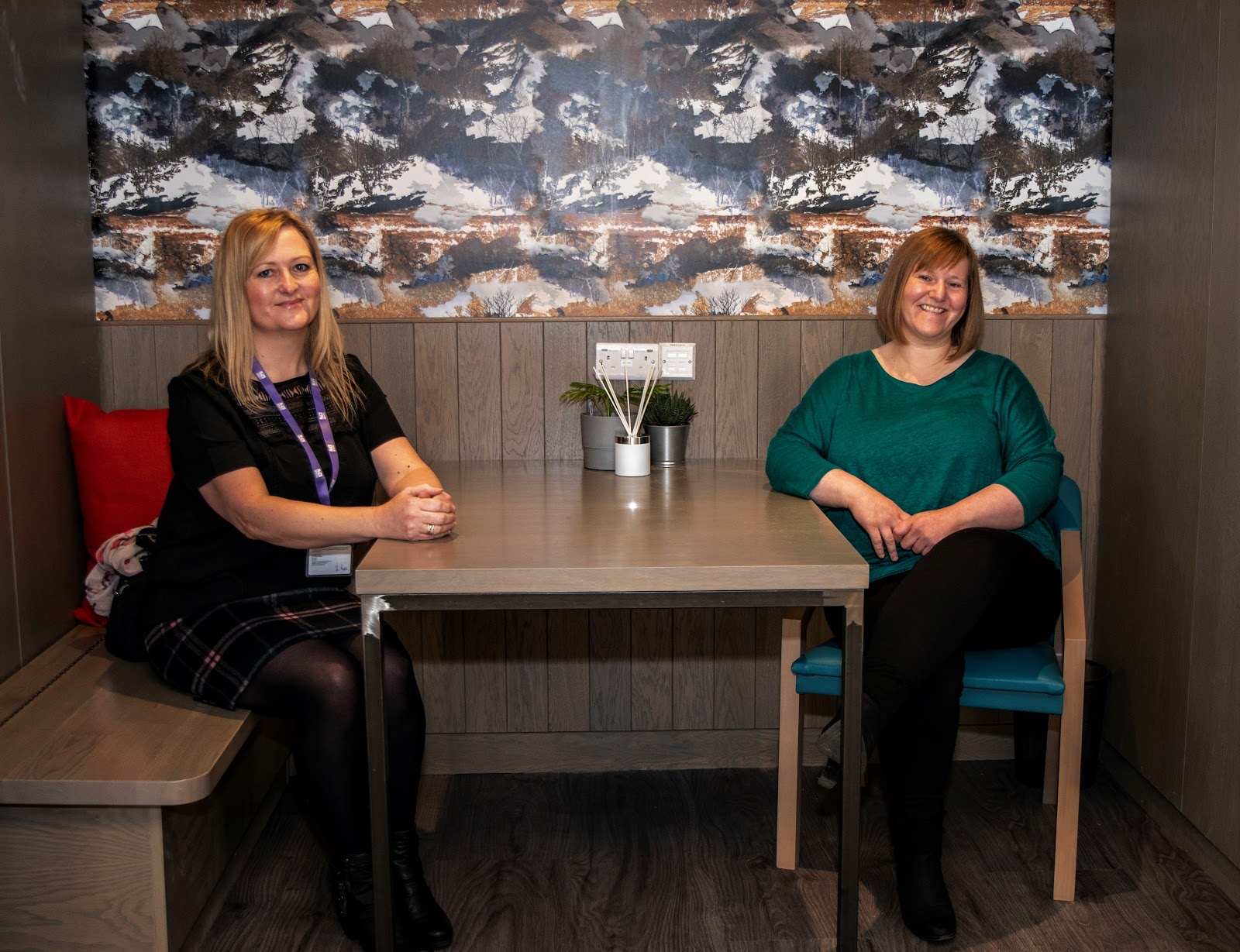 Frances McKinlay, chief officer, Marie Trust and her colleague, Lynn Rae, enjoying one of the new chat spaces in the Access Hub.