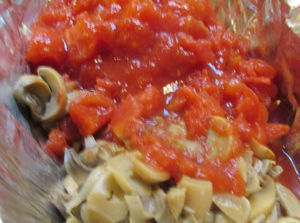 Add drained sliced mushrooms and drained diced tomatoes. Cook for about 3 minutes or...