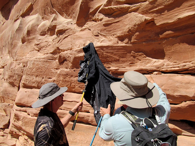 Rigging a sun shade to photograph some pictographs