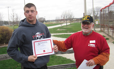 Photo: Active Duty Army Paul Turnbaugh shows off his certificate from Run 4 Vets