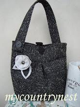 Photo: borsa di tessuto pesante grigio antracite melange con fiore di panno