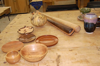 Photo: Another view of items brought in for show from our Panelists -- bowls by Chuck Engstrom, a beautifully-spalted hollow form and gallery-quality baseball bats by David Fry, and pottery by Sally Giarratana.