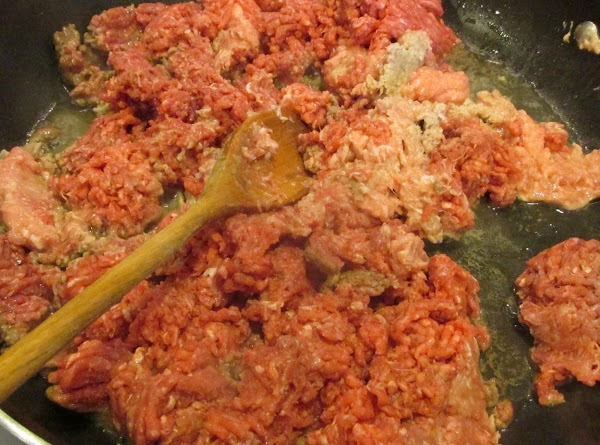 Cook over medium high heat. Break up meat chunks as it cooks with a...