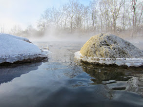 Photo: Mist on a morning river with ice-rimmed rocks at Eastwood Park in Dayton, Ohio.