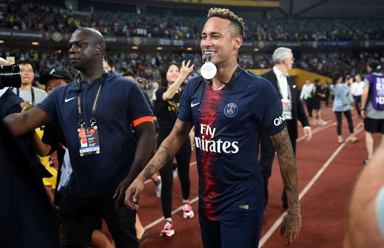 Paris Saint-Germain's Brazilian forward Neymar Jr celebrates with team mates after winning the French Trophy of Champions football match between Monaco and Paris Saint-Germain on August 4, 2018 in Shenzhen.