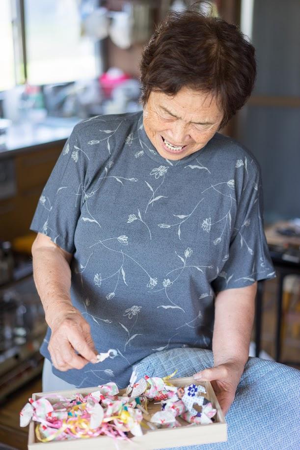 笑顔で語る川本富子さん