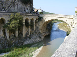 Photo: The Roman Bridge [Pont Romain] is exceptionally well preserved for its 2000 years, and still in active use. When a devastating flood of the river Ouvêze struck the area in September, 1992 (with considerable loss of life and property), the bridge survived intact.