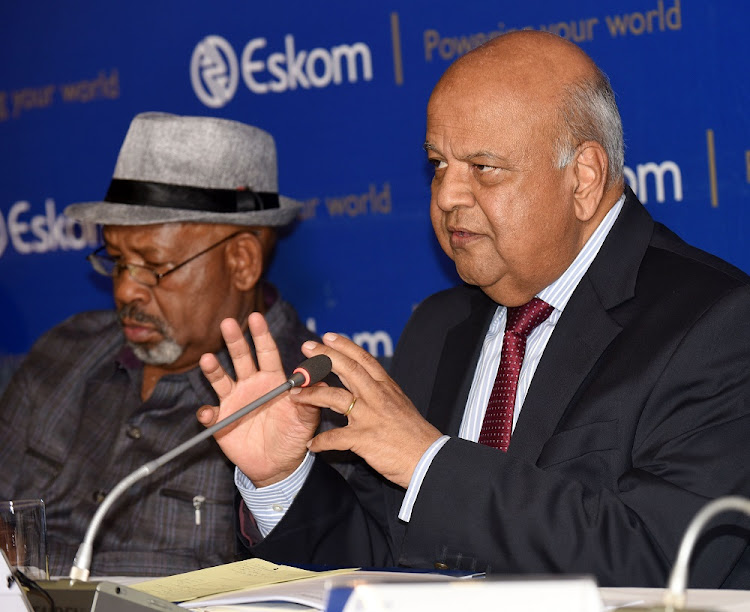 Public enterprises minister Pravin Gordhan, right, and Eskom board chair Jabu Mabuza at a briefing in December 2018. Picture: FREDDY MAVUNDA