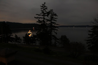 Photo: Yacht in West Sound. Viewed from the porch at Hogan House.
