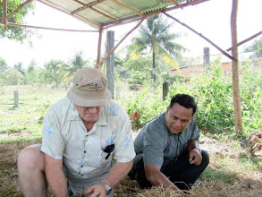 Photo: Missionary and Cambodian staff member working in the LCMS mulching pit
