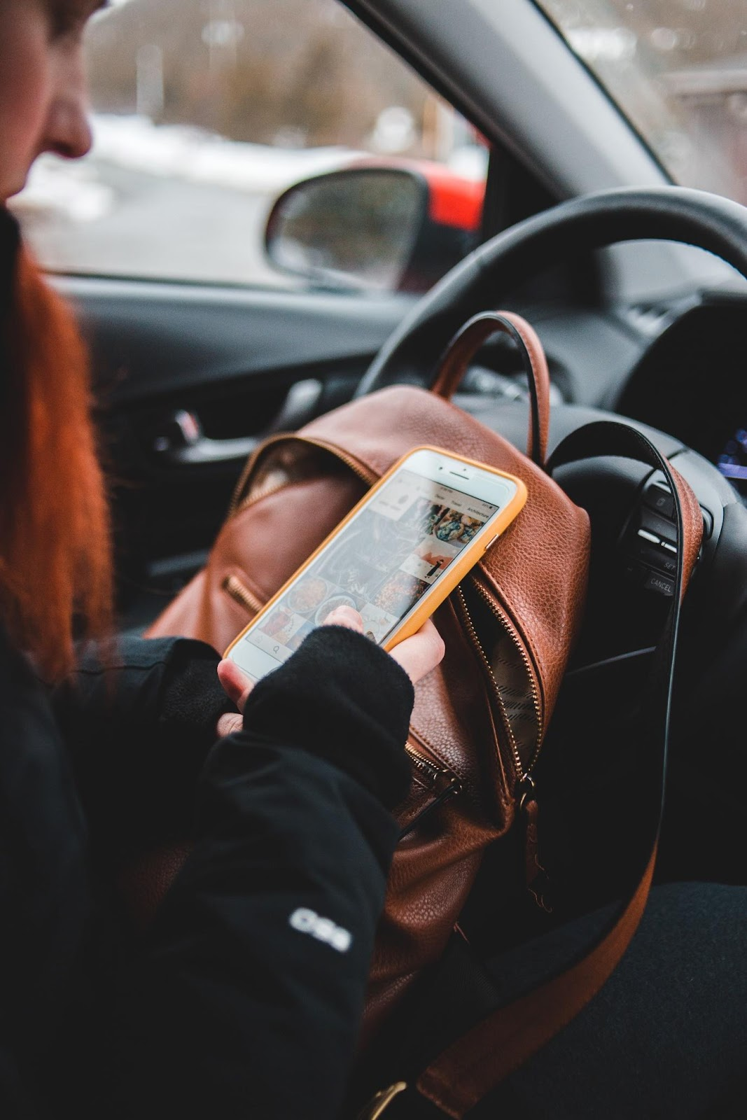 A person reading a book in a car  Description automatically generated with medium confidence