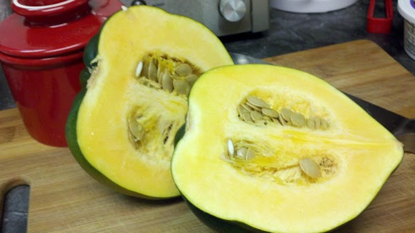 Cut squash in half lengthwise. No need to remove seeds at this point; they...