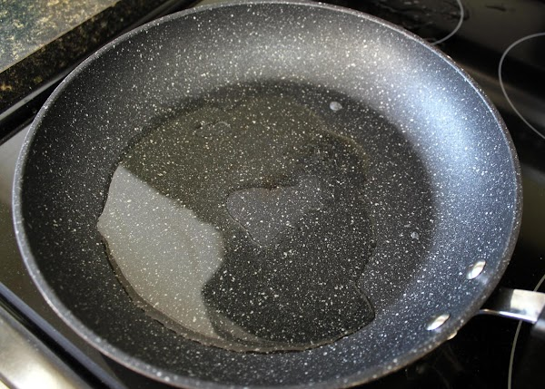 Heat oil in a large skillet.