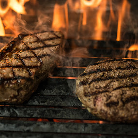 Flame grilled steaks by Claude Lupien - Food & Drink Cooking & Baking ( steak, charcoal, burger, flames, grill, meat )