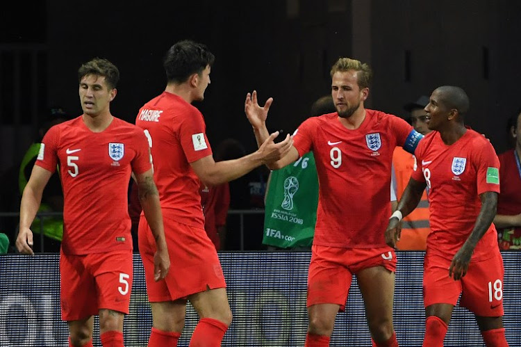 England's forward Harry Kane (2R) celebrates his second goal with teammates during the Russia 2018 World Cup Group G football match between Tunisia and England at the Volgograd Arena in Volgograd on June 18, 2018.