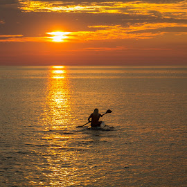 Solitude by Carolann Horton - Sports & Fitness Watersports ( solitary, lake huron, sunset, kayak, trabquility, golden,  )