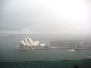 Photo: We climbed a pylon of the Harbor Bridge to get this view.  Its really raining...