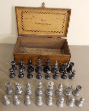Photo: 'White's Aluminum Chess' (not owned)  An interesting-looking set that appeared on US eBay recently. It attracted me on a number of counts.   Unfortunately, to date, I have been singularly unable to find out anything regarding the set or its origins! If anyone has information, it will be gratefully received. I 'guess' it as being early C20th, pre-WW1.  Interesting is the spelling of the word 'Aluminum'. As an Englishman, I had always grown up believing this was the US spelling for the metal that we call 'Aluminium' (with extra 'i'). However, on looking matters up some time ago  (eg see http://www.worldwidewords.org/articles/aluminium.htm  for a good brief history of the discovery of the metal and its 'naming') the issue is by no means as straightforward as this!   Although the spelling may not be definitive, my suspicion is that this is likely to have been an American-made set.  This album lacks any real conclusions at this stage. Its aim is to draw attention to similarities that may be resolved in due course.