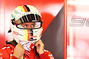 Ferrari driver Sebastian Vettel of Germany prepares for practice for the F1 Grand Prix of Great Britain at Silverstone, England.