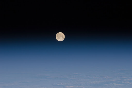 One of a series of photos of the moon and Earth s atmosphere as seen from the International Space Station.