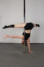Photo: Vertical Pole Gymnastics - One Handed Back-Shoulder Handstand with Straddle Leg Line