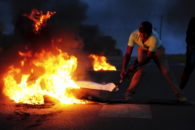 A protester pictured during a service delivery protest in Ekangala, Gauteng. Picture: GALLO IMAGES/CITY PRESS/LEON SADIKI