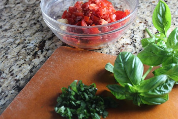 If making homemade bruschetta prepare that first. Preheat oven to 400. While the oven...