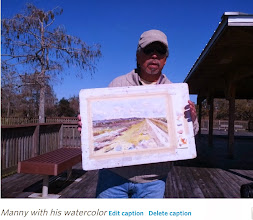 Photo: Manny Jamok with his painting at Loxahatchee